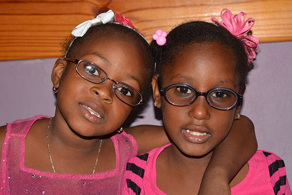 two young girls wearing glasses